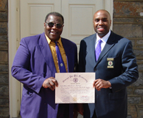 Dr. Andrew Jackson and Dr. Marcus Whitehurst receiving the Chapter Charter for the Omega Psi Phi Iota Lambda Lambda Chapter.